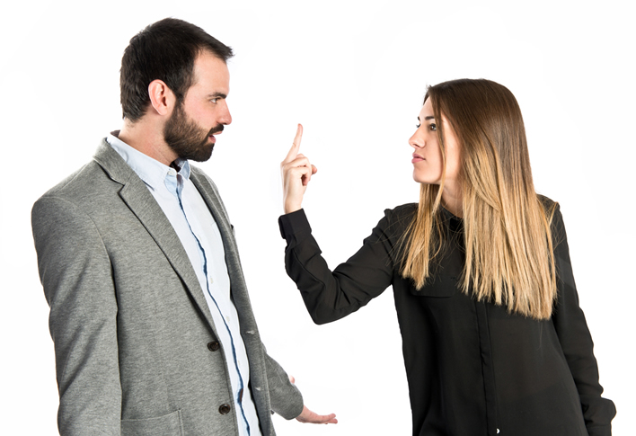 Woman telling man off with middle finger for bad compliment
